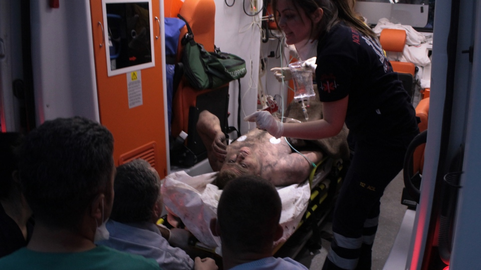 Medics place an injured miner into an ambulance after an explosion and fire at a coal mine in Soma, in western Turkey, Tuesday, May 13, 2014. (AP / Depo Photos)