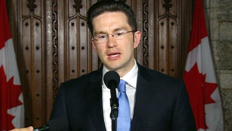 Minister of State (Democratic Reform) Pierre Poilievre speaks with the media following the passage of Bill C-23, in Ottawa, Tuesday, May 13, 2014.