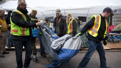 City workers remove a tent from outside the Vancouver Art Gallery where the Occupy Vancouver protesters & Tents fire hazards removed from Occupy Vancouver | CTV Vancouver News