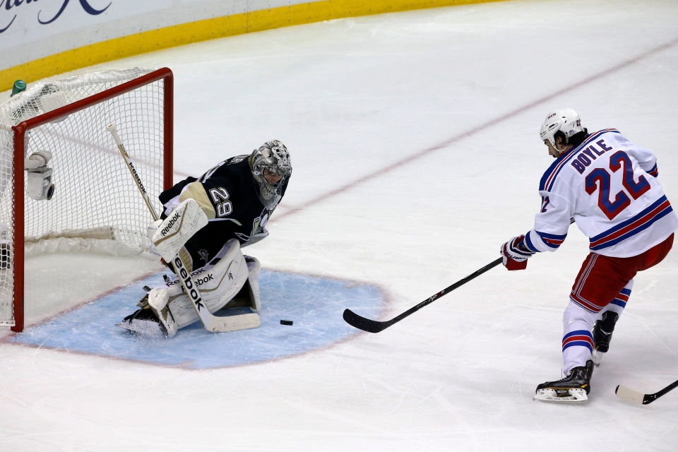 New York Rangers' Brian Boyle (22) fires a shot past Pittsburgh Penguins goalie Marc-Andre Fleury (29) for a goal in the first period of Game 7 of a second-round NHL playoff hockey series, in Pittsburgh on Tuesday, May 13, 2014. (AP)