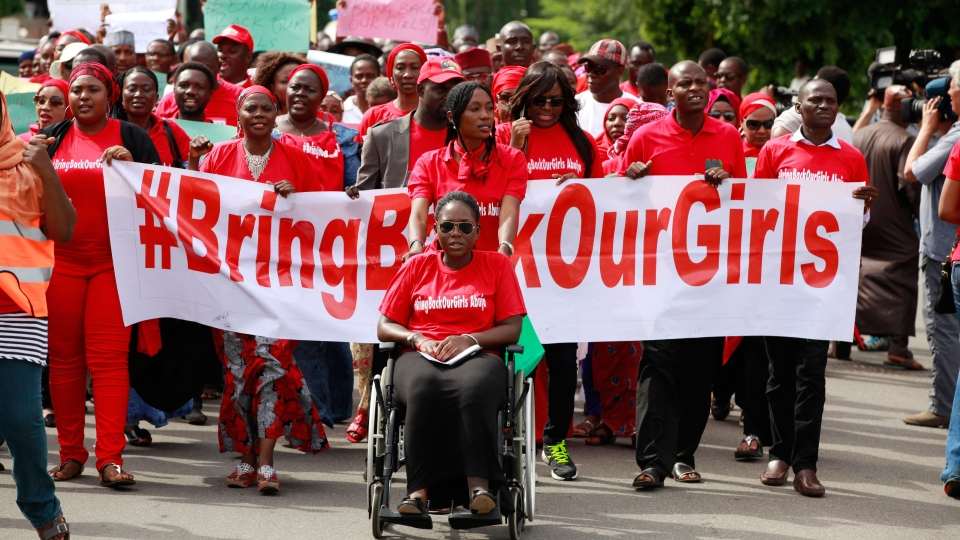 People attend a demonstration calling on the government to rescue the kidnapped schoolgirls of the Chibok secondary school, in Abuja, Nigeria, Tuesday, May 13, 2014. (AP / Sunday Alamba)