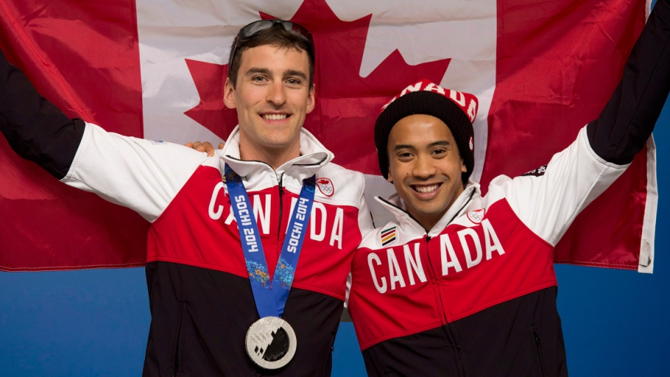 Canadian speedskaters Denny Morrison and Gilmore Junio at the Sochi Winter Olympics on Sunday February 16, 2014. (THE CANADIAN PRESS / Adrian Wyld)