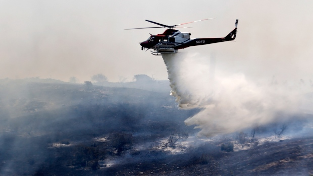 Fighting wildfire north of San Diego, California