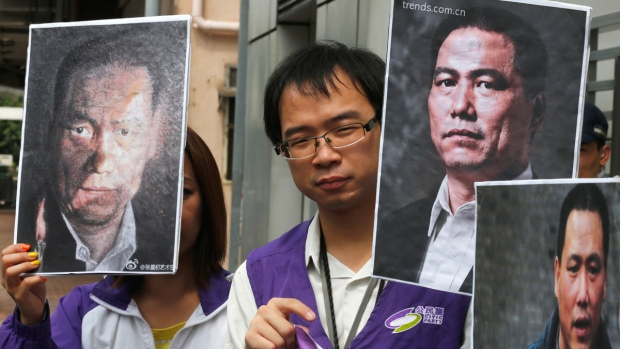 Holding pictures of Pu Zhiqiang in Hong Kong