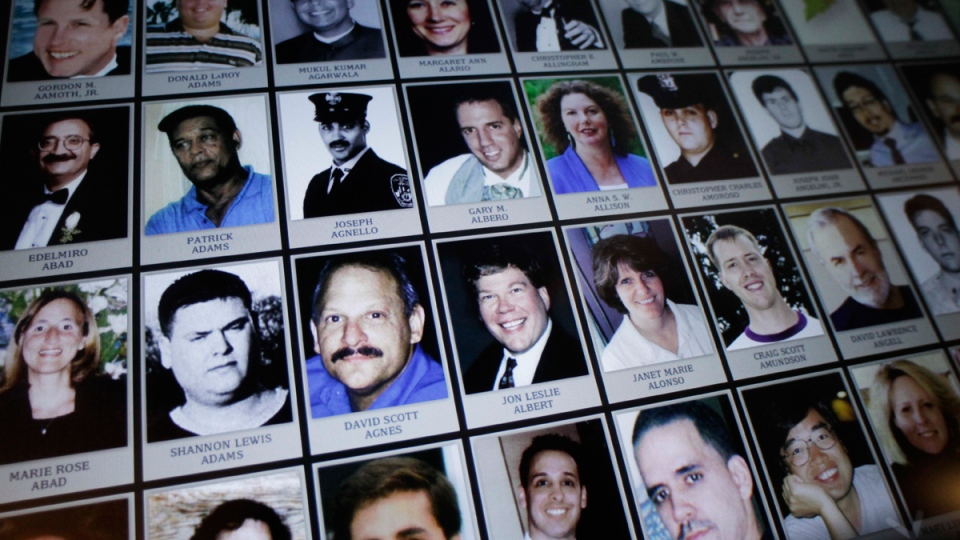This Sept. 10, 2012 file photo shows electronic images of victims of the attacks of Sept. 11, 2001. (AP / Mark Lennihan, File)