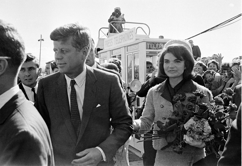 This Nov. 22, 1963 file photo shows President John F. Kennedy and his wife Jacqueline Kennedy upon their arrival at Dallas Airport. (AP)