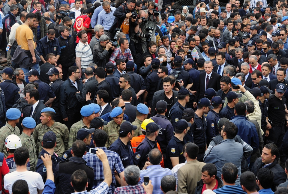 Turkish Prime Minister Recep Tayyip Erdogan, centre right, is surrounded by security members as he visits the coal mine in Soma, Turkey, Wednesday, May 14, 2014. (AP / Emre Tazegul)