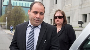 Mohamed Harkat and his wife Sophie Lamarche Harkat leave the Supreme Court of Canada in Ottawa on Wednesday, May 14, 2014. (Adrian Wyld / THE CANADIAN PRESS)
