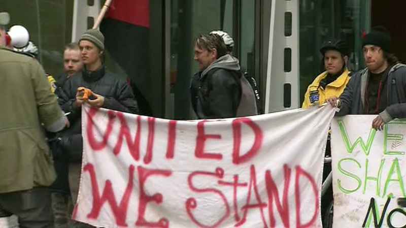 Protesters rally in front of Brookfield Properties on Bay Street in downtown Toronto on Tuesday, Nov. 15, 2011.