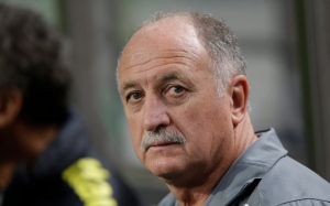 In this Oct.12, 2013, file photo, Brazil's coach Luiz Felipe Scolari waits for the start of their friendly soccer match against South Korea at Seoul World Cup Stadium in Seoul, South Korea. (AP Photo/Lee Jin-man)