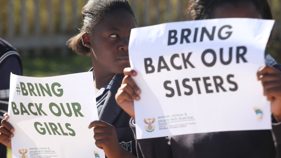 Students from a Soweto school hold posters to support the release of the kidnapped girls in Nigeria, Wednesday May 14, 2014. (AP / Denis Farrell)
