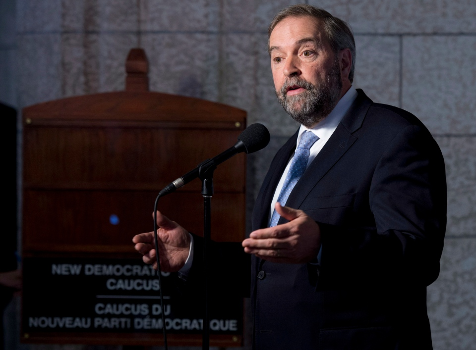 NDP leader Tom Mulcair speaks with the media following caucus on Wednesday, May 14, 2014 in Ottawa. (Adrian Wyld / THE CANADIAN PRESS)