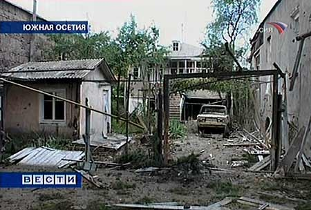 Damaged houses are seen at a street in a town of Tskhinvali, capital of breakaway Georgian enclave South Ossetia, in this image made from television on Sunday, Aug. 10, 2008. (AP Photo/RTR Russian Channel)