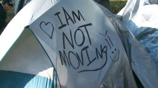 A message is scrawled on an Occupy Toronto tent at St. James Park, Tuesday, Nov. 15, 2011.