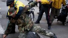 Police apprehend an Occupy Toronto protester in downtown Toronto, Tuesday, Nov. 15, 2011.  (James MacDonald / THE CANADIAN PRESS)