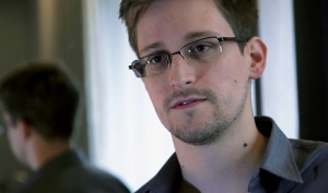 A Sunday, June 9, 2013, file photo provided by The Guardian newspaper in London shows Edward Snowden, who worked as a contract employee at the U.S. National Security Agency, in Hong Kong. (AP Photo/The Guardian, File)