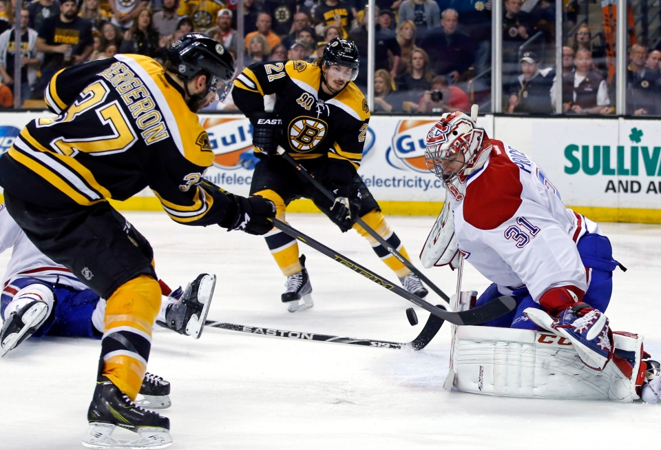 Montreal Canadiens goalie Carey Price (31) protects the net against Boston Bruins center Patrice Bergeron (37) and left wing Loui Eriksson (21) during the second period in Game 7 of an NHL hockey second-round playoff series in Boston, Wednesday, May 14, 2014. (AP Photo/Elise Amendola)