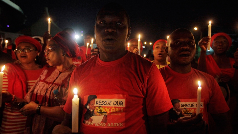 People hold candle light during a vigil to mark one month after the girls of government secondary school Chibok were kidnapped, in Abuja, Nigeria, Wednesday, May 14, 2014. (AP / Sunday Alamba)