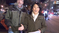 A protester interrupts CTV British Columbia's Mi-Jung Lee while she reports from the Occupy Vancouver tent city. Nov. 15, 2011. (CTV)