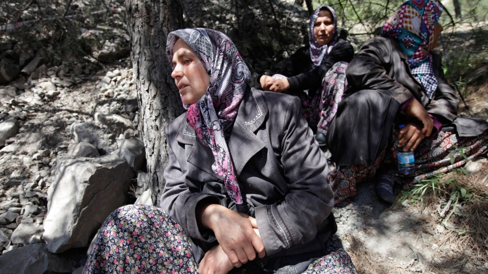 Relatives of miners wait near a coal mine in Soma, western Turkey, Thursday, May 15, 2014. (AP / Lefteris Pitarakis)
