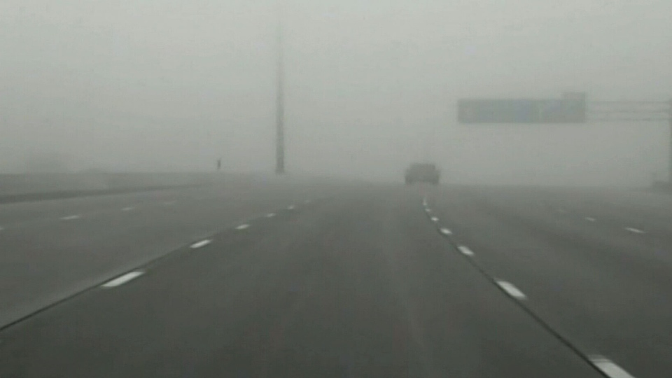 Thick fog causes poor visibility on Highway 401 in Toronto, Thursday, May 15, 2014.