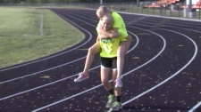 Twin piggyback injured twin sister over finish lin