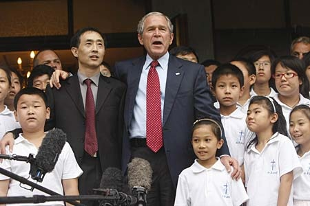 Accompanied by Pastor Jian-An, President Bush makes remarks after attending church at the Beijing Kuanjie Protestant Christian Church during his visit to the 2008 Summer Olympic games in Beijing, China on Sunday, Aug. 10, 2008. (AP Photo/Gerald Herbert)