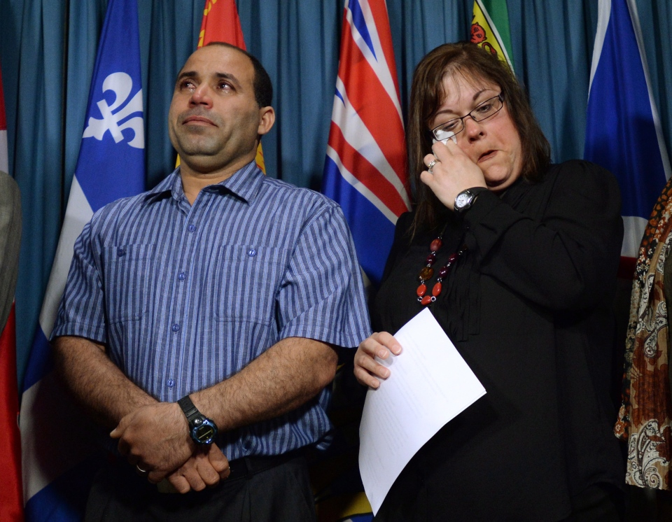 Mohamed Harkat and his wife Sophie Lamarche Harkat take part in a press conference on Parliament Hill in Ottawa on Thursday, May 15, 2014. (Sean Kilpatrick / THE CANADIAN PRESS)