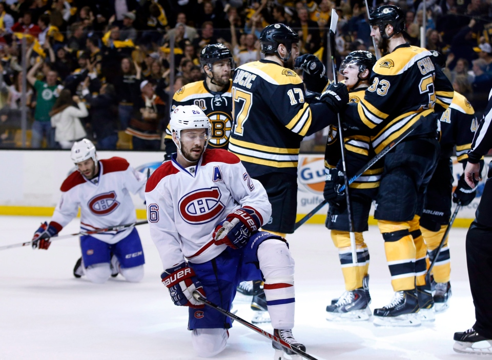 Montreal Canadiens defensemen Josh Gorges (26) and Mike Weaver, left, react as Boston Bruins defenseman Zdeno Chara (33), defenseman Torey Krug (47) and left wing Milan Lucic (17) celebrate a goal by right wing Jarome Iginla, left, during the second period in Game 7 of an NHL hockey second-round playoff series in Boston, Wednesday, May 14, 2014. (AP / Elise Amendola)