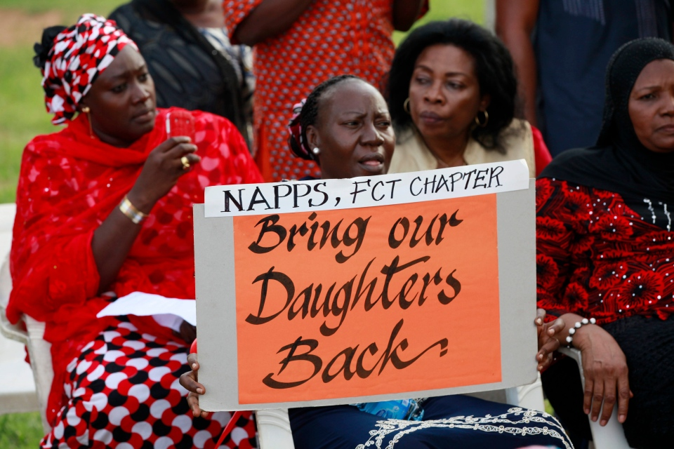 Women attend a sit down rally calling on the government to rescue the kidnapped school girls of the Chibok secondary school, in Abuja, Nigeria, Thursday, May 15, 2014. (AP Photo/Sunday Alamba)