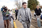 Jonathan Pratt leaves the courthouse in Wetaskiwin, Alberta on May 15, 2014. (Jason Franson / THE CANADIAN PRESS)