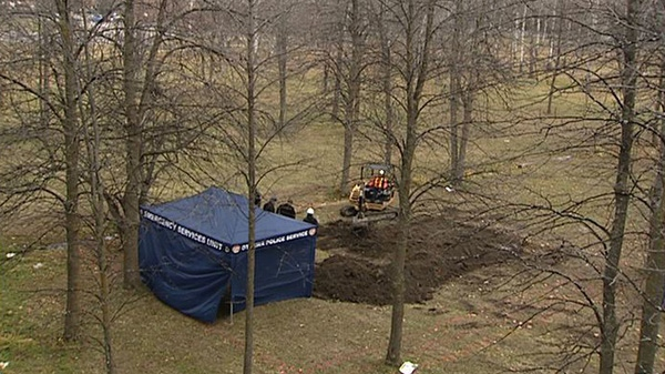 Police search Heatherington Road park in connection with human remains found nearby on Wednesday, Nov. 16, 2011.