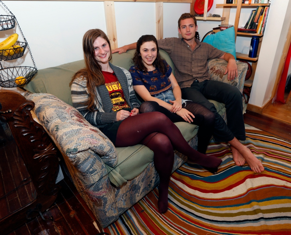 Lara Russo, Cally Guasti and Reese Werkhoven sit on a couch in their apartment in New Paltz, N.Y. on Thursday, May 15, 2014. (AP / Mike Groll)