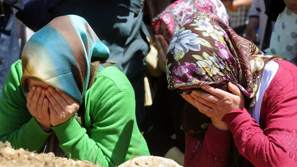 Family members cry during the funerals of mine accident victims in Soma, Turkey, Thursday, May 15, 2014. (AP / Emre Tazegul)