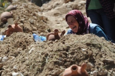 A woman cries at the grave