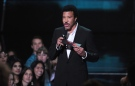 Lionel Richie speaks on stage at the iHeartRadio Music Awards at the Shrine Auditorium on Thursday, May 1, 2014, in Los Angeles. (Photo by Chris Pizzello/Invision/AP)