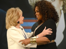 Oprah Winfrey embracing Barbara Walters