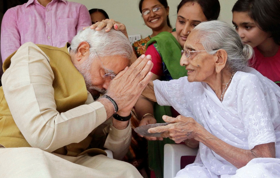 90-year-old Hiraben blesses her son and India's next prime minister Narendra Modi at her home in Gandhinagar, in the western Indian state of Gujarat, Friday, May 16, 2014. (AP Photo)