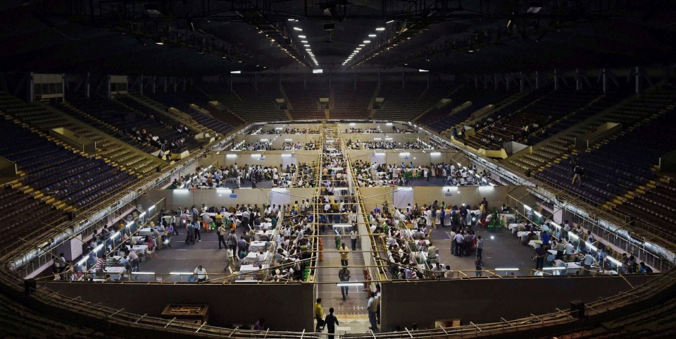 Indian election officials count votes at an indoor stadium in Kolkata, India, Friday, May 16, 2014. (AP Photo)