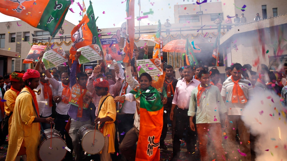 India's main opposition Bharatiya Janata Party (BJP) supporters celebrate outside the party office in Gandhinagar, in the western Indian state of Gujarat, Friday, May 16, 2014. (AP / Saurabh Das)