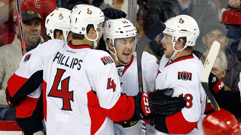 Ottawa Senators' Bobby Butler, centre, celebrates his game winning goal with teammates Chris Phillips, left, and Jesse Winchester during third period NHL hockey action against the Calgary Flames in Calgary, Alta., Tuesday, Nov. 15, 2011. The Ottawa Senators beat the Calgary Flames 3-1.THE CANADIAN PRESS/Jeff McIntosh