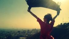 Iranian women take photos without headscarves