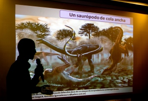 Paleontologist Pablo Gallina speaks to the press about a newly discovered dinosaur discovered in Argentina in Buenos Aires, Argentina, Thursday, May 15, 2014. (AP / Natacha Pisarenko)
