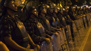 Police officers stand guard during a protest against the money spent on the World Cup preparations, in Rio de Janeiro, Brazil, Thursday, May 15, 2014. (AP / Hassan Ammar)