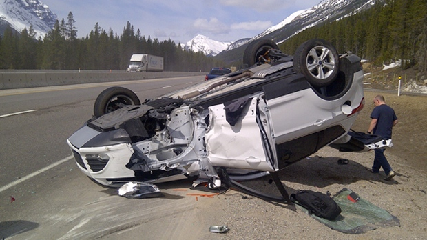 A toppled Ford Escape following a Friday morning crash west of Lake Louise
