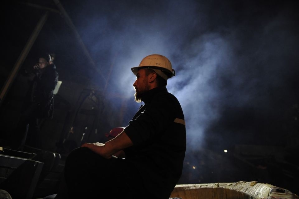 A Turkish miner is shown at the entrance of the coal mine in Soma, Turkey on Saturday, May 17, 2014. (AP / Emre Tazegul)