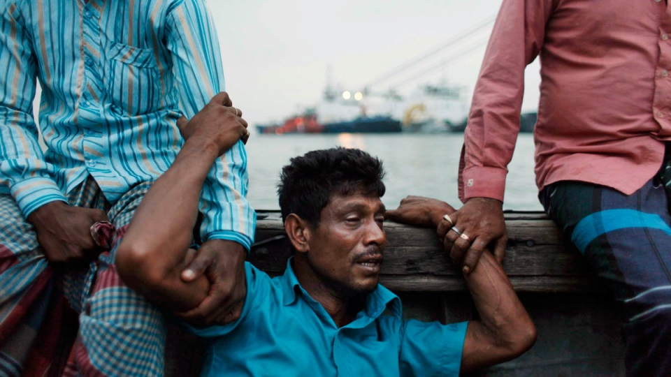 A Bangladeshi man mourns for his missing brother, as rescuers continue to search the site of a ferry that sank, on the banks of the River Meghna in Munshiganj district, in Bangladesh, Friday, May 16, 2014. (AP Photo/Suvra Kanti Das)