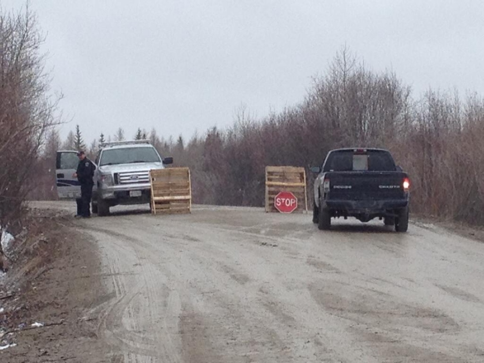 Police block off the road to a flooded area in Attawapiskat on Friday, May 16, 2014. (Jonathan P Nakogee / Twitter)