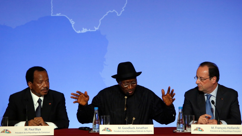 "Nigeria President Goodluck Jonathan, center, answers reporter's questions as Cameroon President Paul Biya, left, and French President Francois Hollande look on during the press conference ending the ""Paris Summit for Security in Nigeria"", at the Elysee Palace, in Paris on Saturday, May 17, 2014. (AP / Francois Mori)"