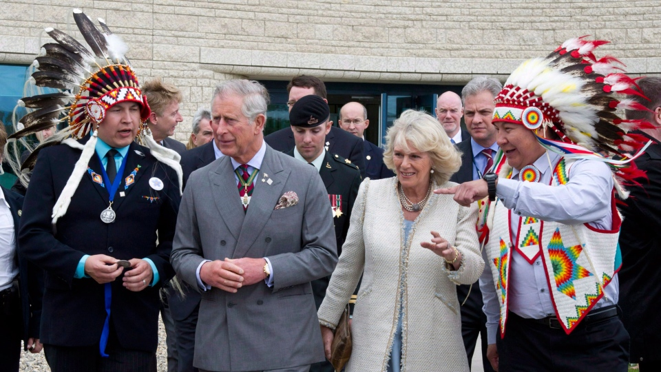 Prince Charles and his wife Camilla visit the Aboriginal University in Regina during their last visit to Canada, on May 23, 2012. (Paul Chiasson / THE CANADIAN PRESS)